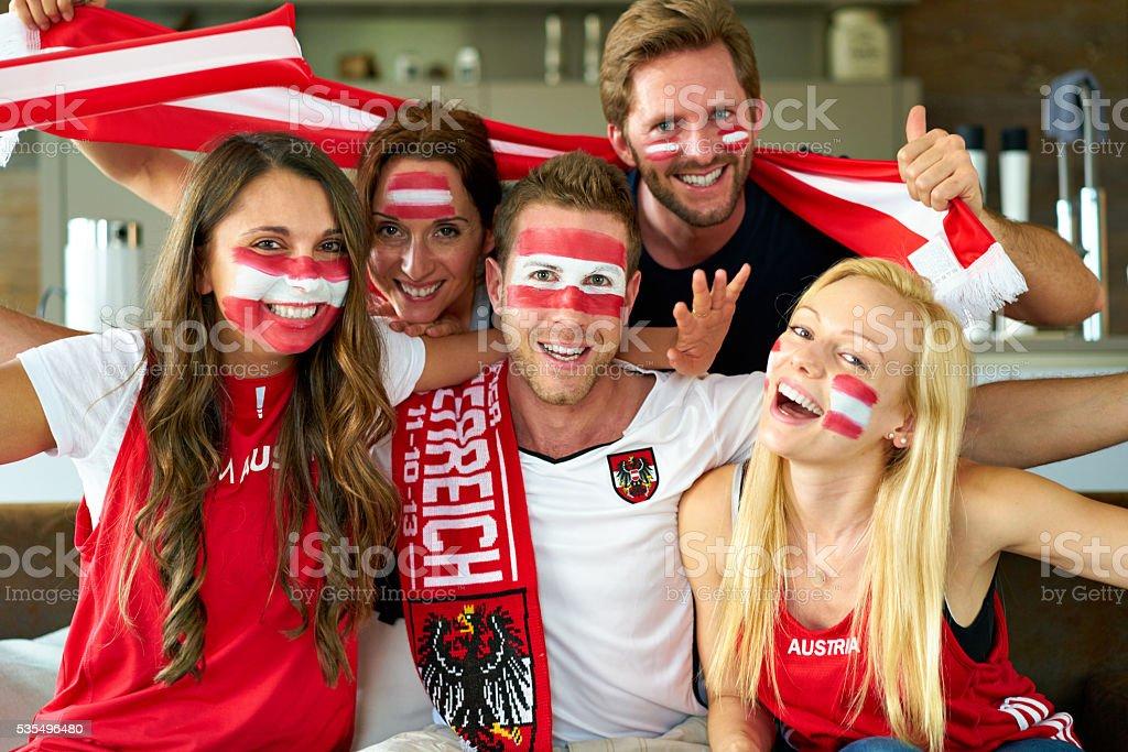 cheering austrian soccer fans stock photo