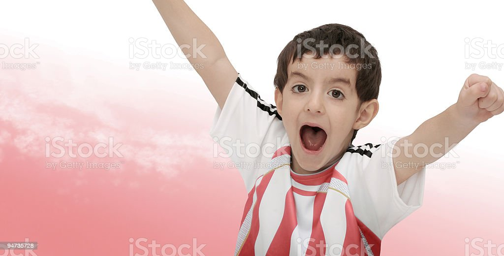 Cheering boy as little soccer player royalty-free stock photo