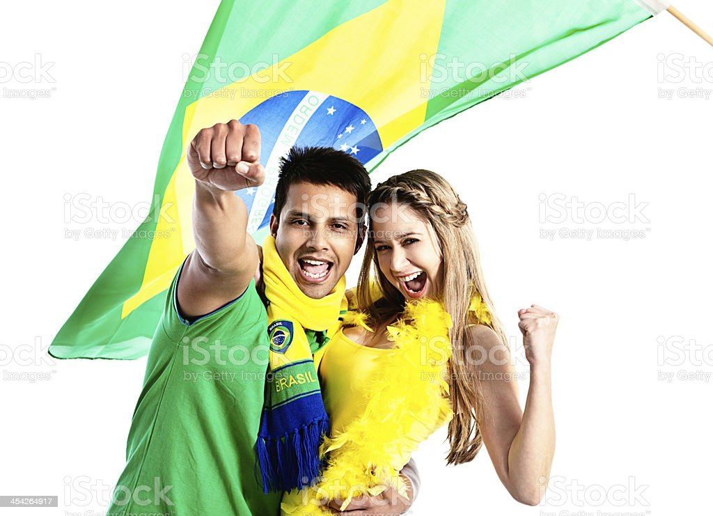 Cheering Brazilian soccer supporting couple punch the air enthusiastically royalty-free stock photo