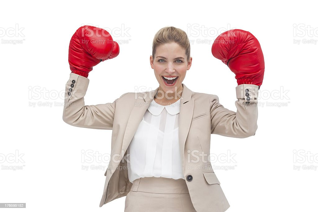 Cheering businesswoman with boxing gloves royalty-free stock photo