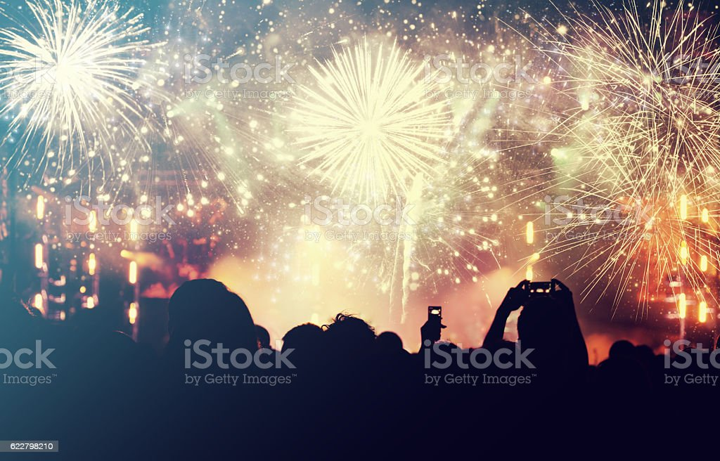 Cheering crowd and fireworks - New Year concept stock photo