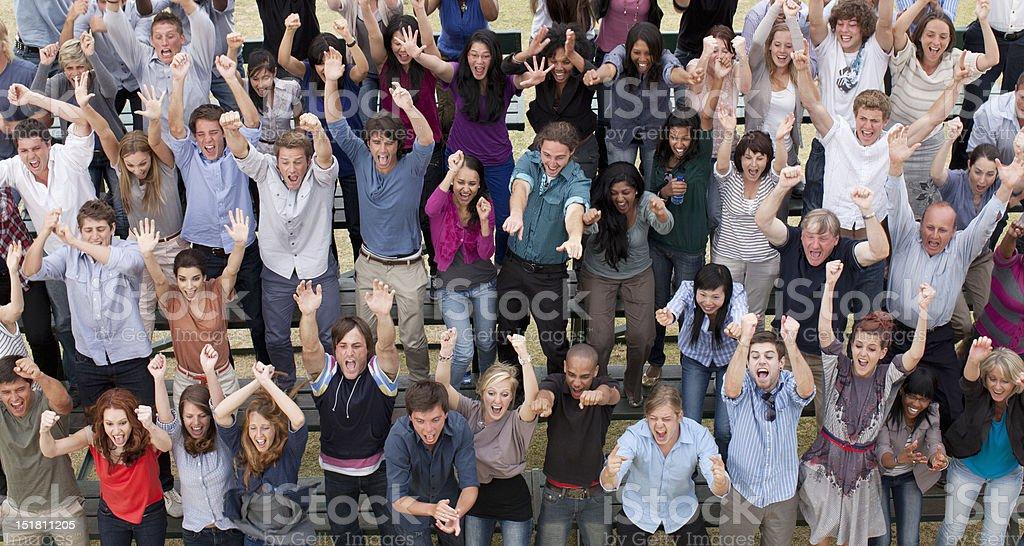 Cheering crowd in bleachers stock photo