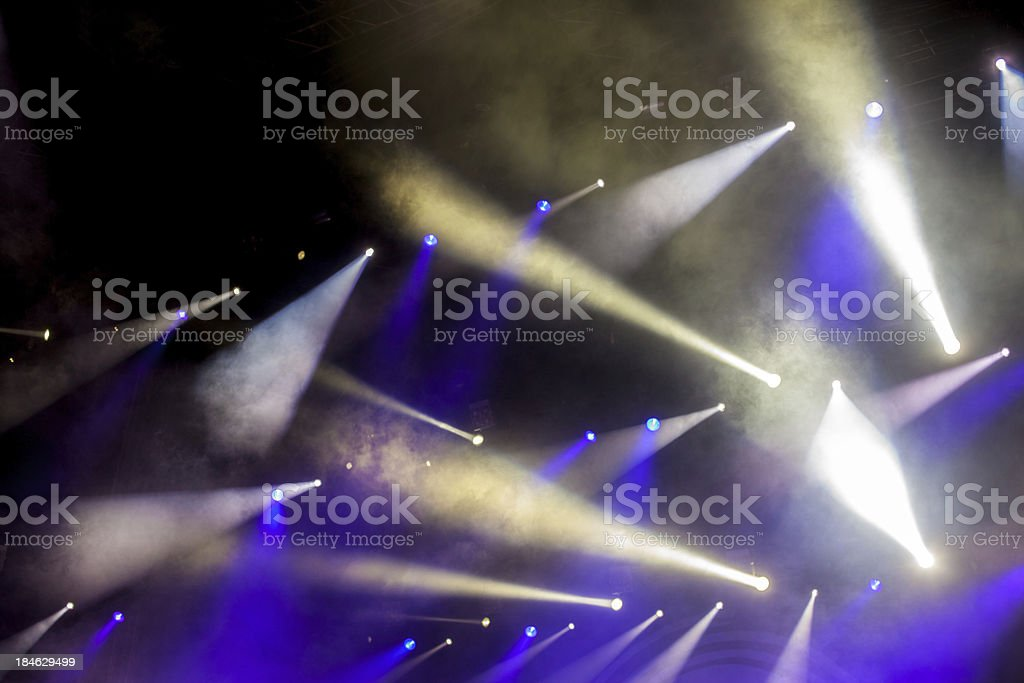 cheering crowd in front of bright stage lights stock photo