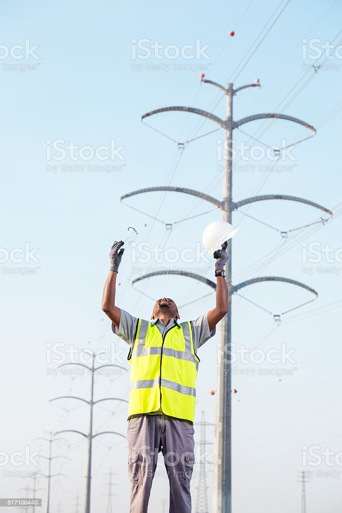 Cheering electrical power engineer. stock photo