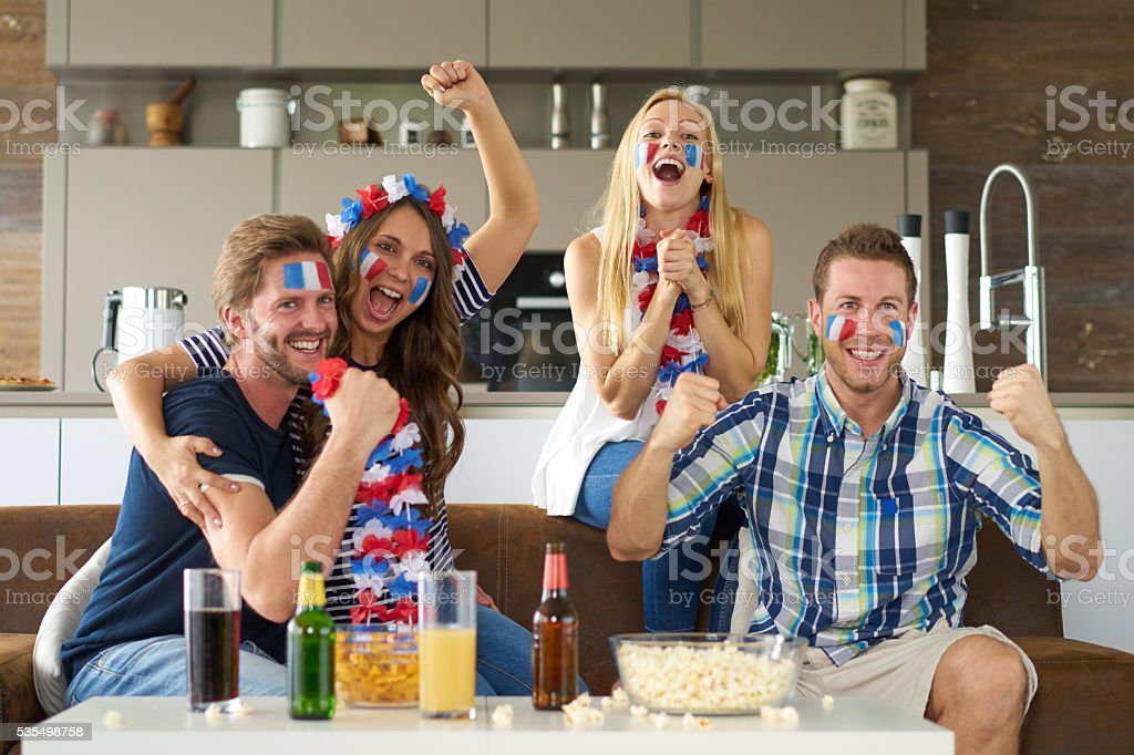 cheering french soccer fans stock photo