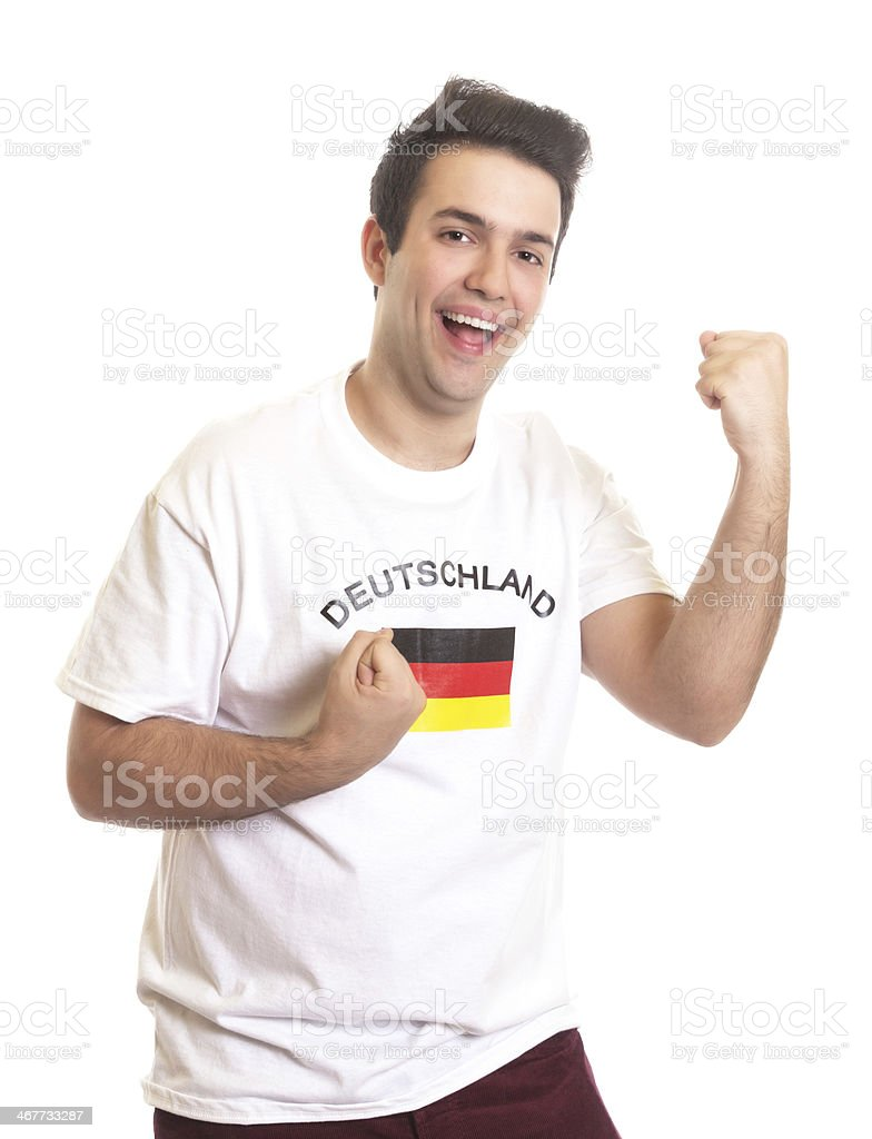 Cheering german sports fan with black hair stock photo