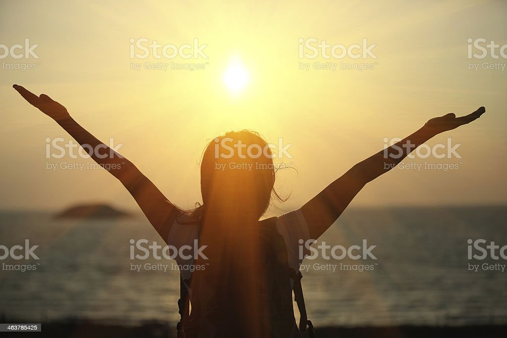 cheering hiking woman sunrise seaside stock photo