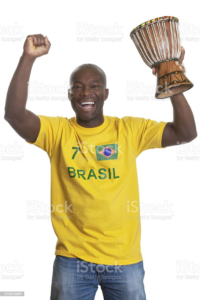 Cheering man from brazil with drum stock photo
