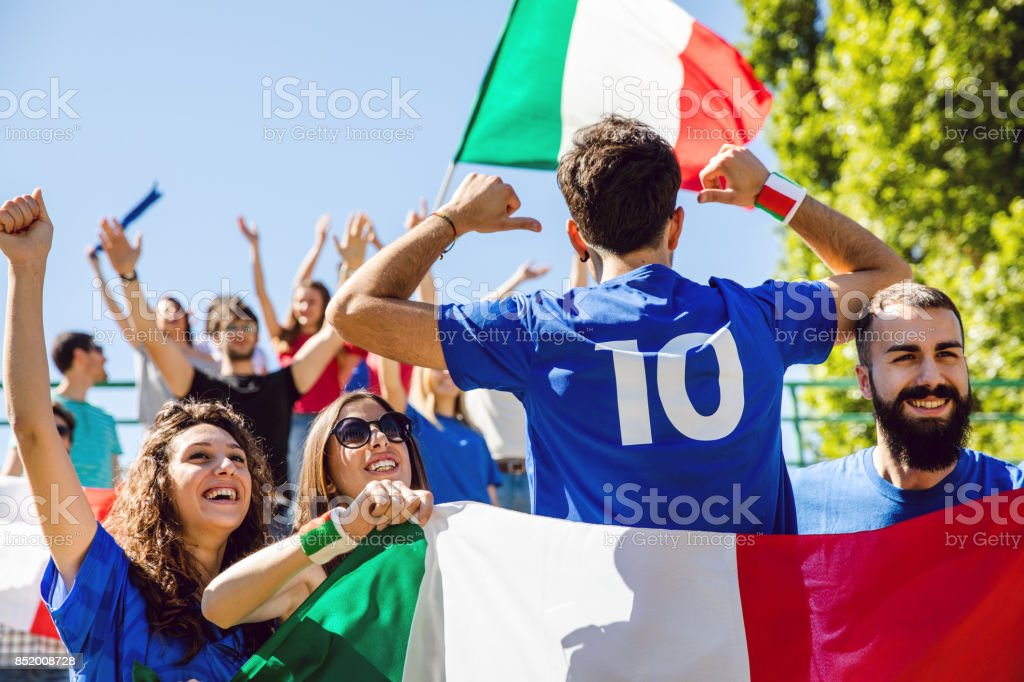 Cheering multi-ethnic game supporters stock photo