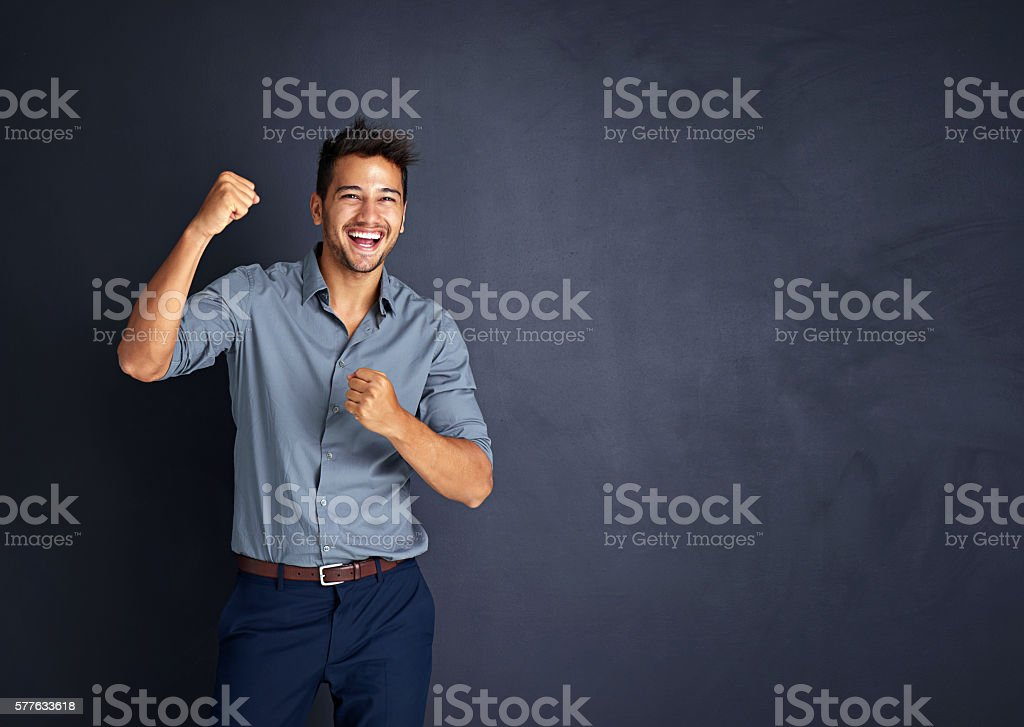 Cheering on through all his achievements stock photo