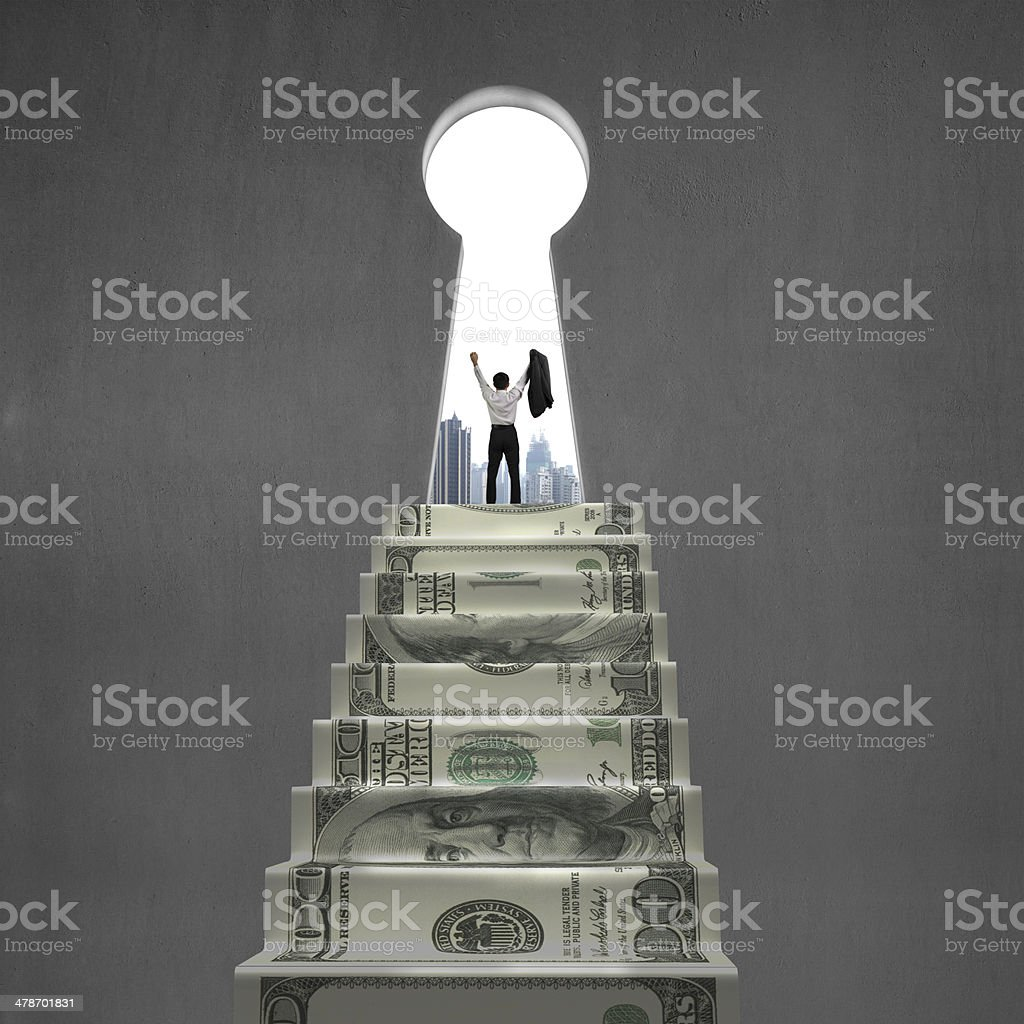 Cheering on top of money stairs with key hole stock photo