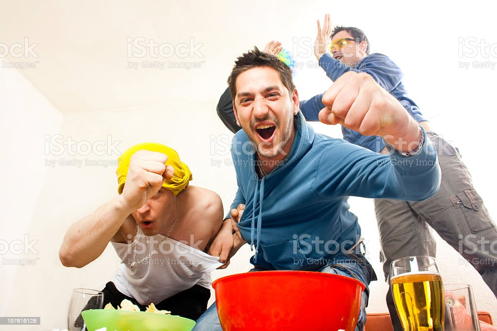 Cheering soccer or football fans with snacks and beer stock photo