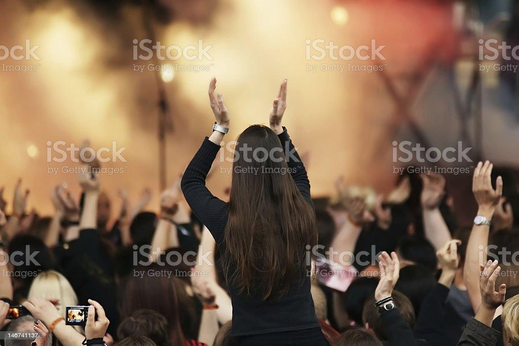 Cheering woman at concert royalty-free stock photo