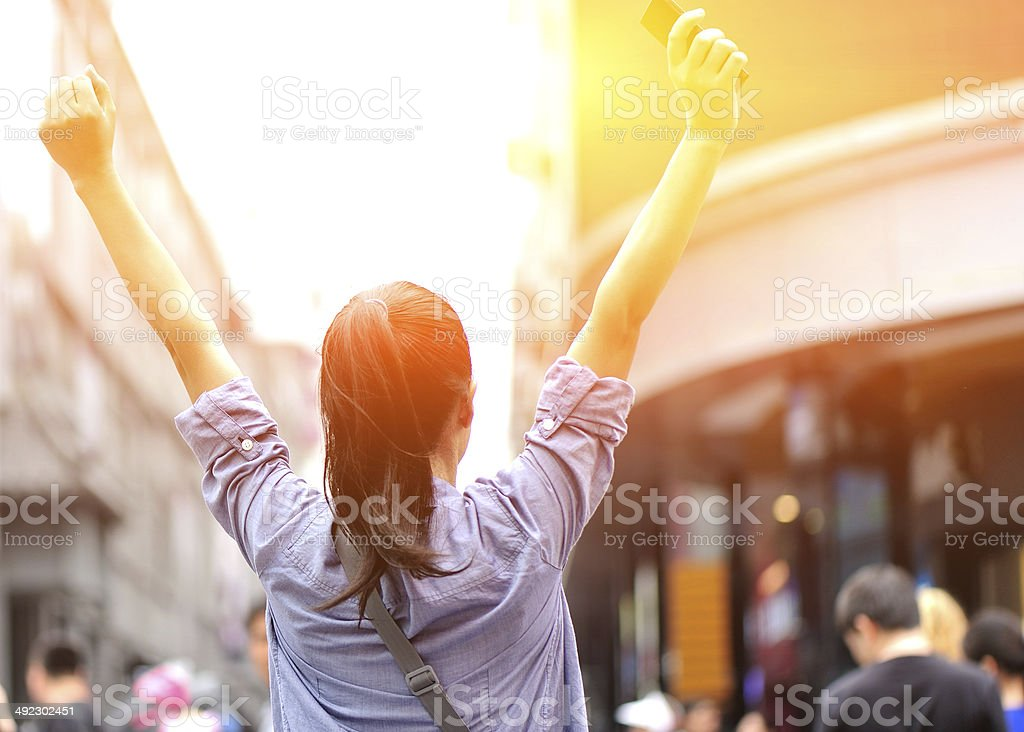 cheering woman on the street stock photo