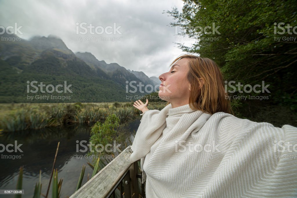 Cheering woman open's heart to nature stock photo