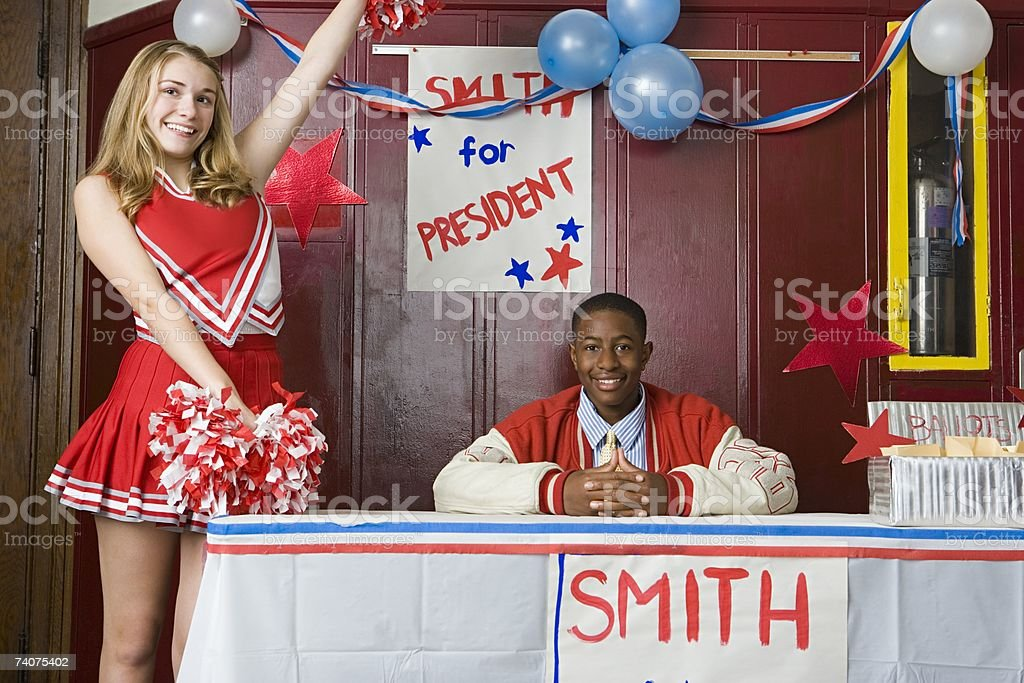 Cheerleader and boy running for president stock photo