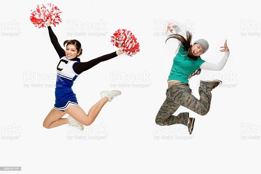 Cheerleader and skater stock photo