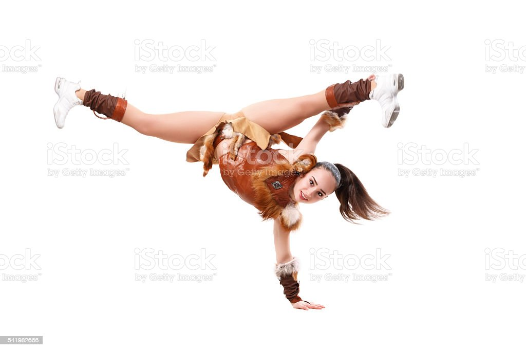 cheerleader dressed in a warrior costume standing on one hand. stock photo