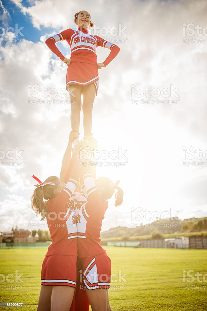 Cheerleader girl on top of the success royalty-free stock photo