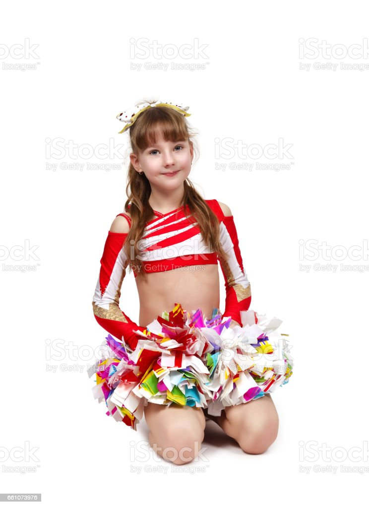 cheerleader girl sitting with pom stock photo