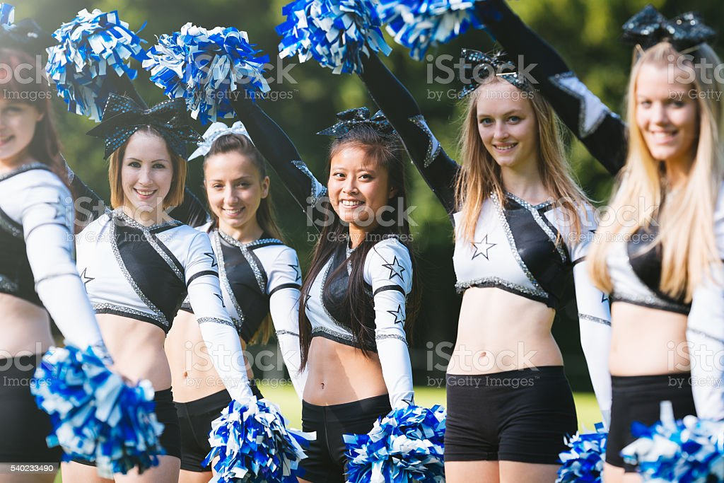 Cheerleader group with pom-pom together stock photo