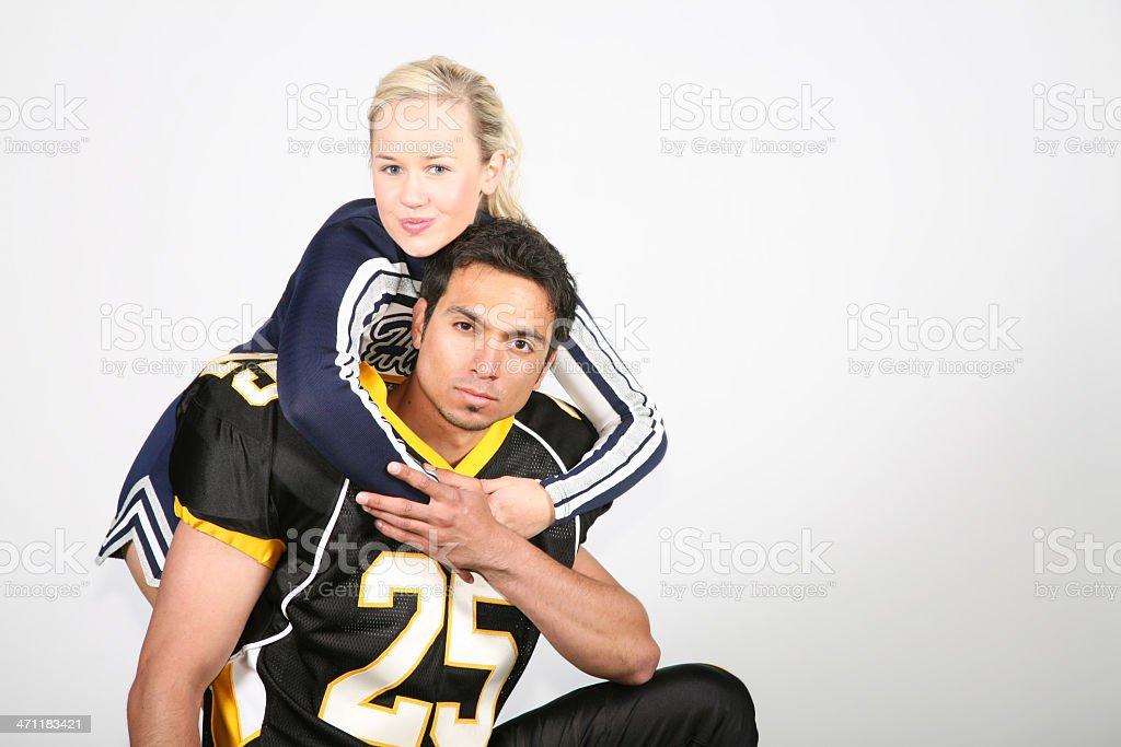 Cheerleader Hugging Football Player royalty-free stock photo