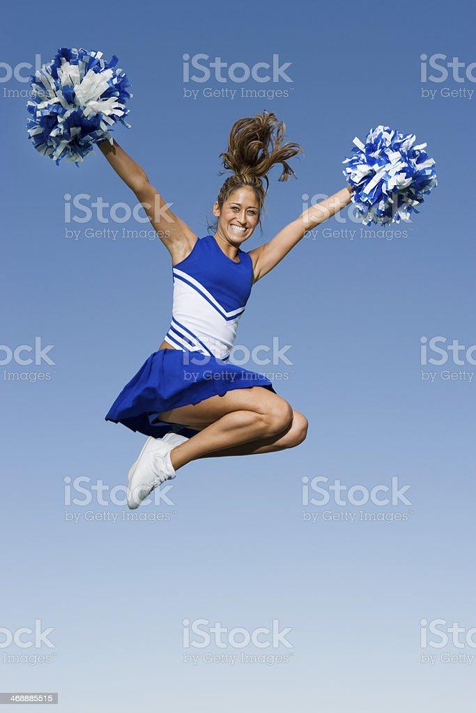 Cheerleader Jumping in Mid-Air stock photo