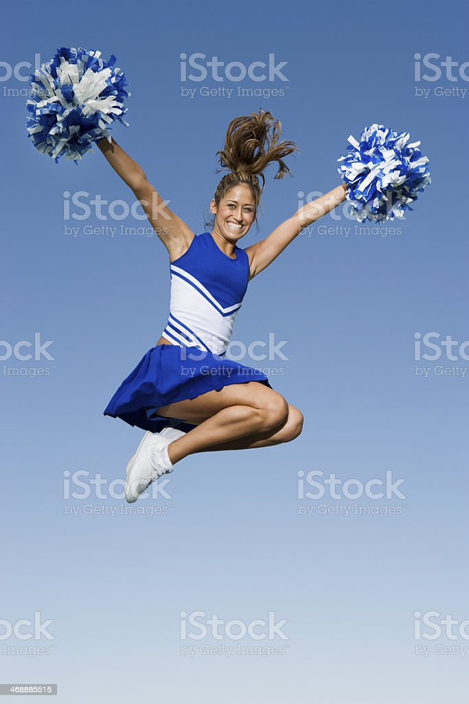 Cheerleader Jumping in Mid-Air stock photo