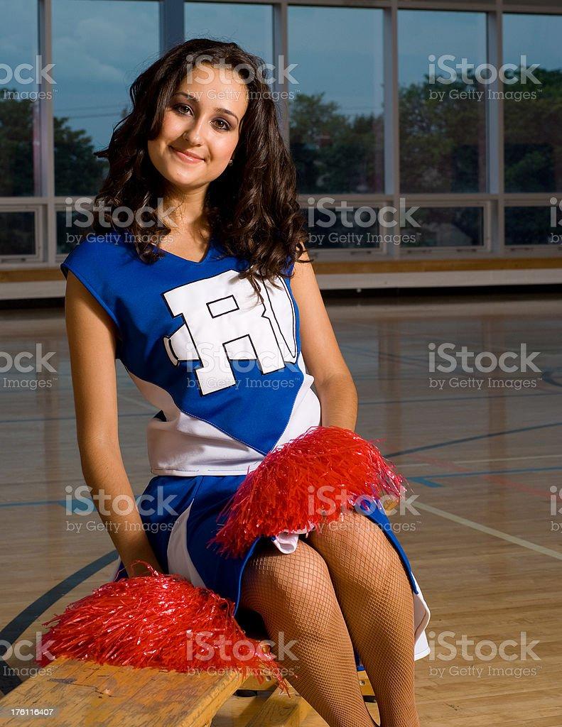 Cheerleader Sitting  in Gymnasium stock photo