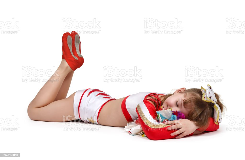 cheerleader with color pompons sleeps stock photo