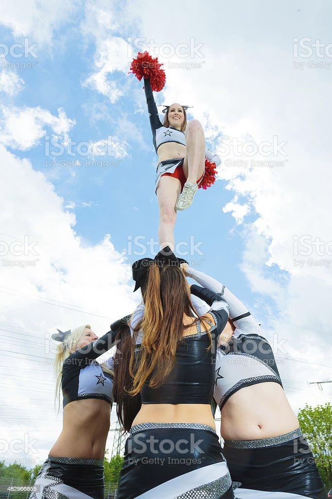 cheerleaders making a pyramid stock photo