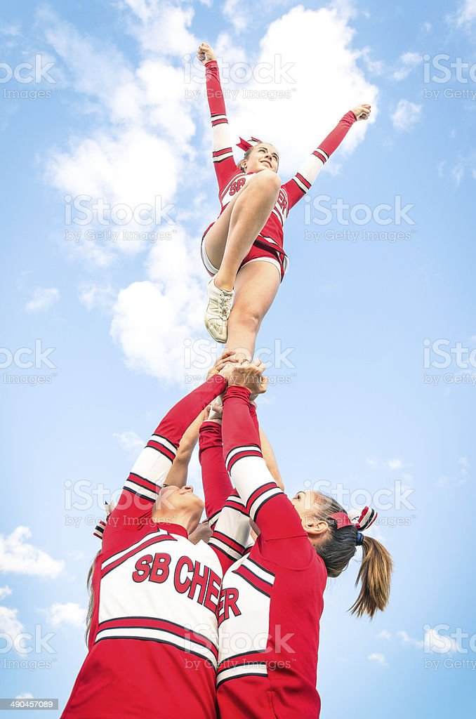 Cheerleaders team during Competition outdoors stock photo