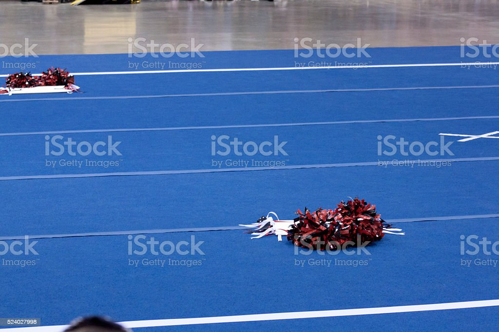 Cheerleading compitition pom poms stock photo