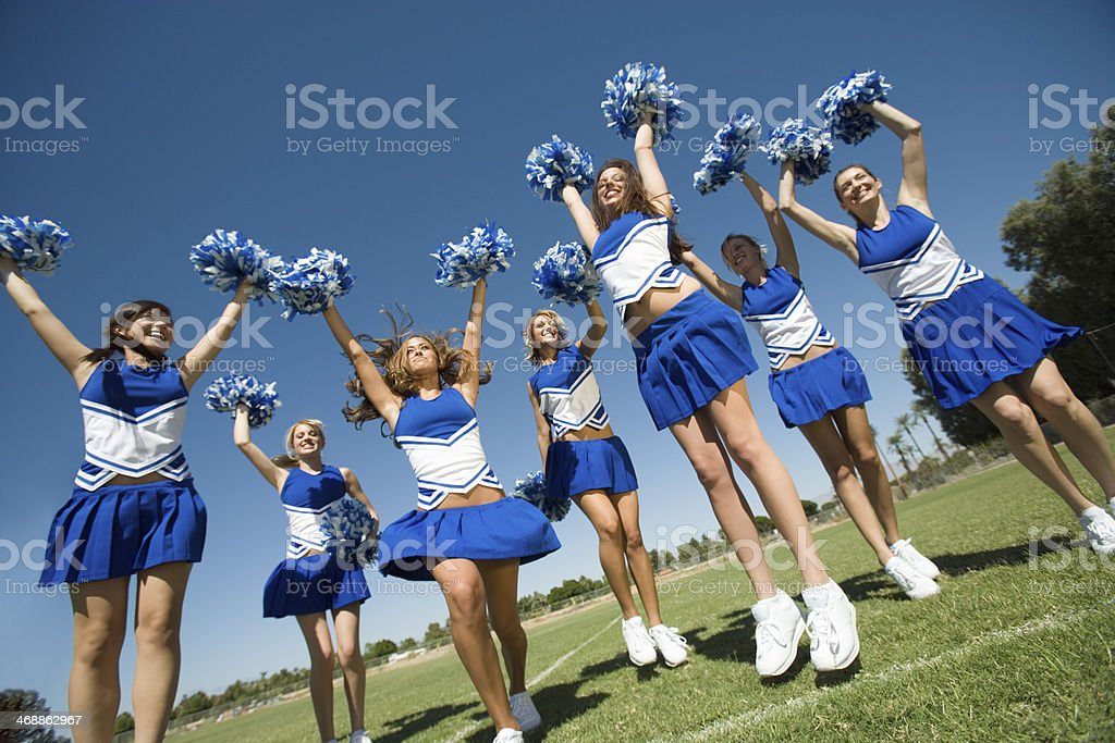 Cheerleading Squad Performing Cheer stock photo