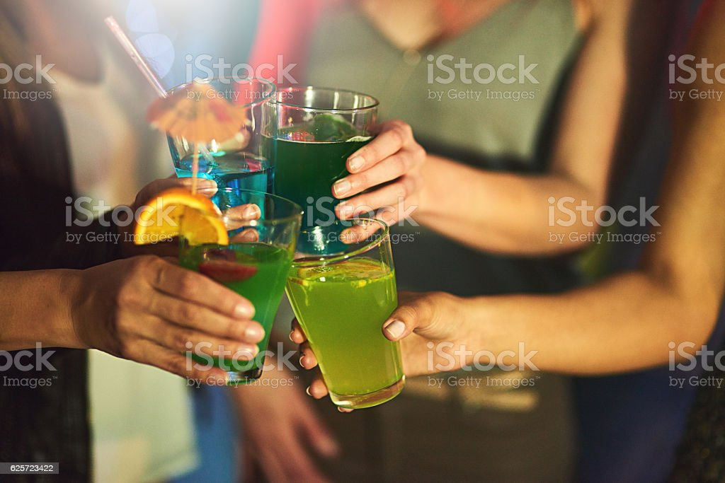 Cheers ladies! Here's to us! stock photo