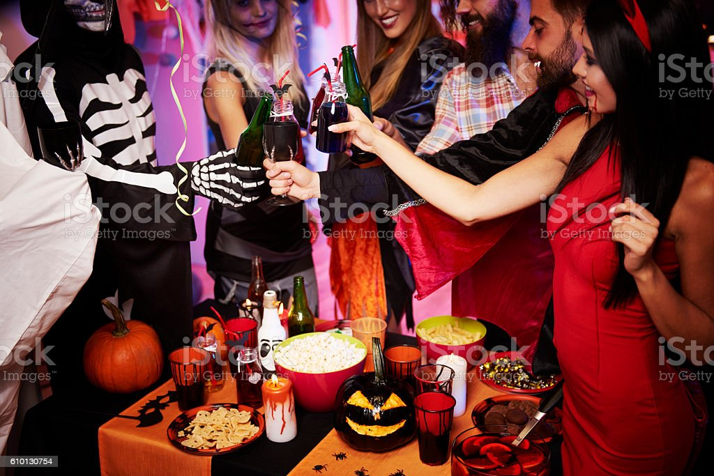 Cheers over the halloween party stock photo