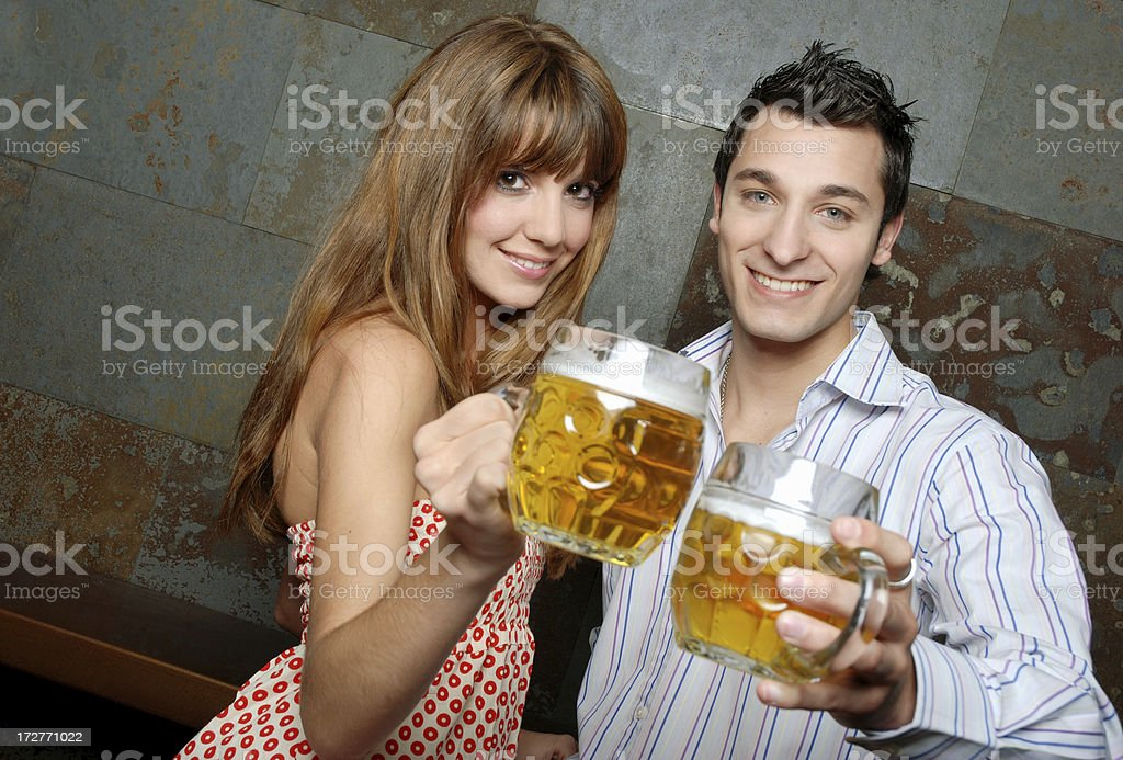 Cheers with beer royalty-free stock photo