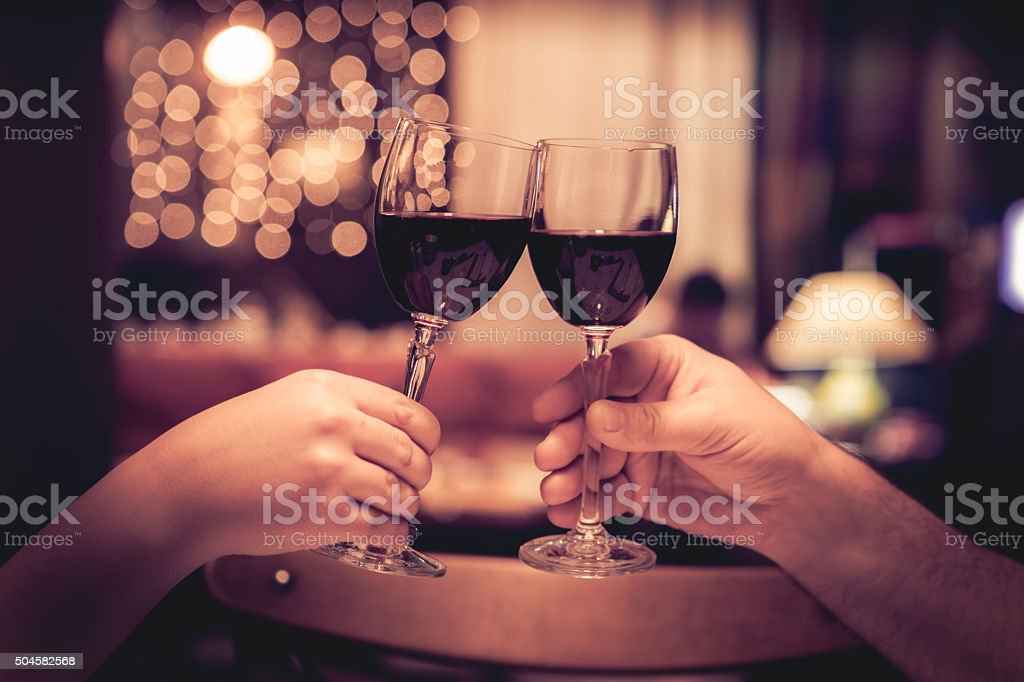Cheers with glasses of red wine stock photo