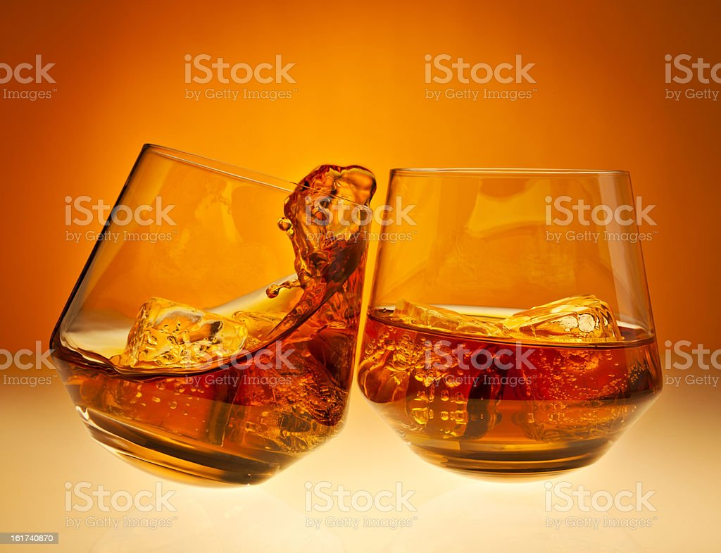 Cheers! with whisky glasses royalty-free stock photo