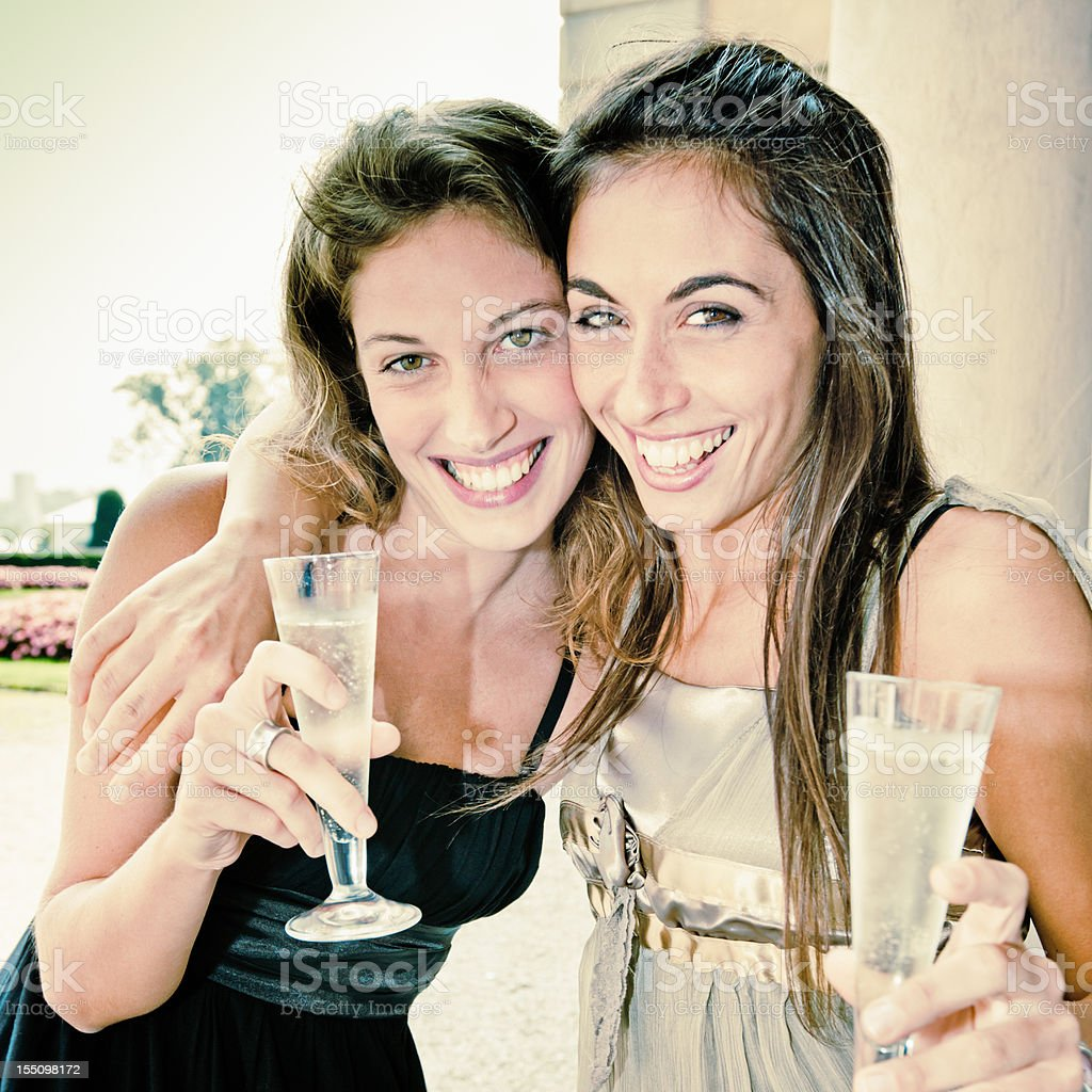 Cheers, Women having fun drinking and toasting with Champagne royalty-free stock photo