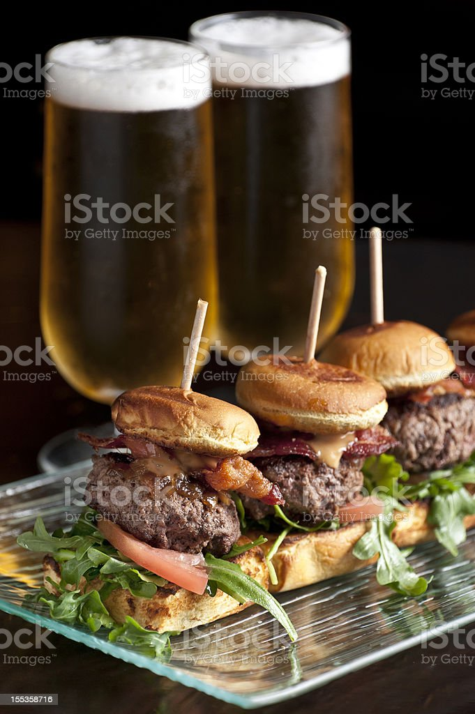 Cheese and bacon burger sliders and beer stock photo