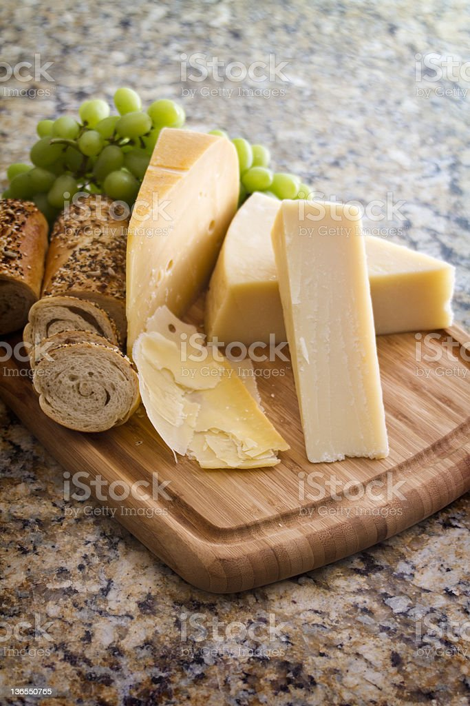 Cheese and Baguette on board stock photo
