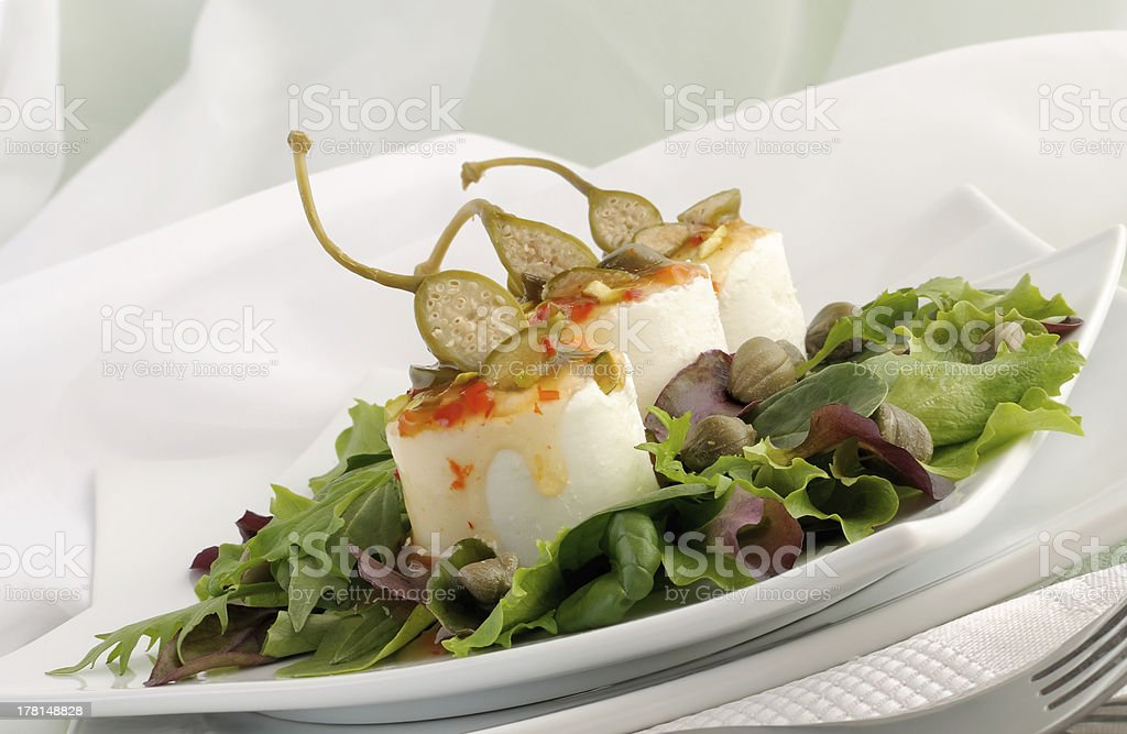 Cheese and capers sweet. sour sauce  pistachios royalty-free stock photo