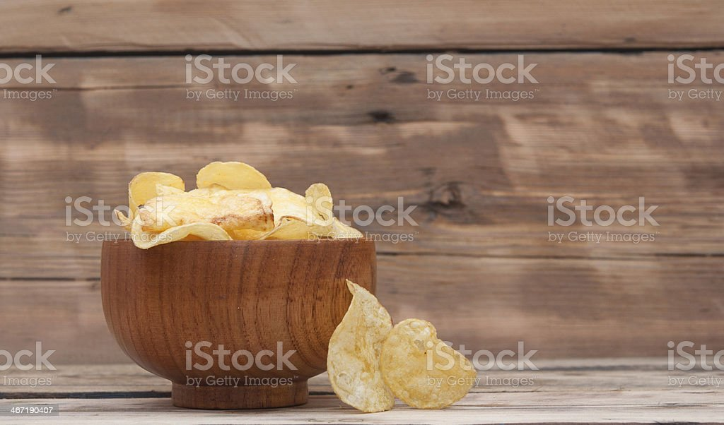 Cheese and chive potato crisp snack in brown bowl stock photo