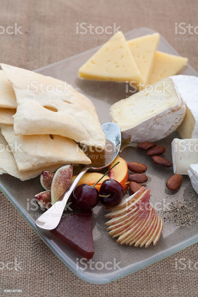 Cheese and fruit plate appetizer stock photo