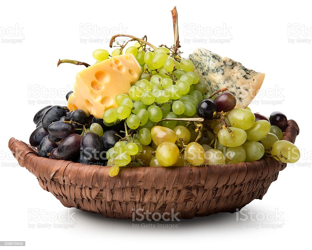 Cheese and grape in basket stock photo