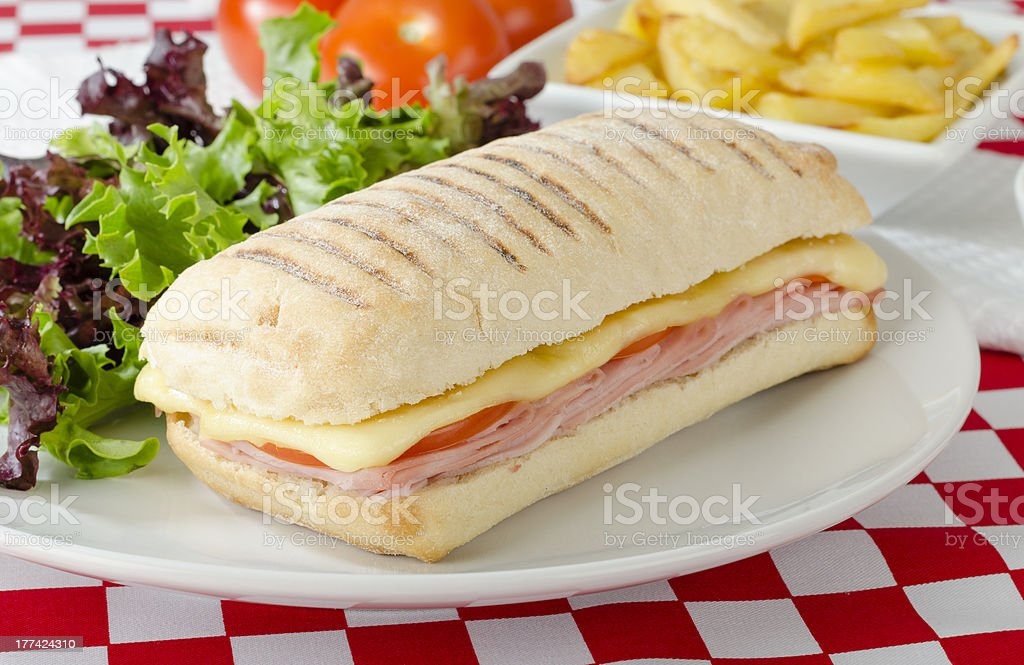 Cheese and ham panini with salad stock photo