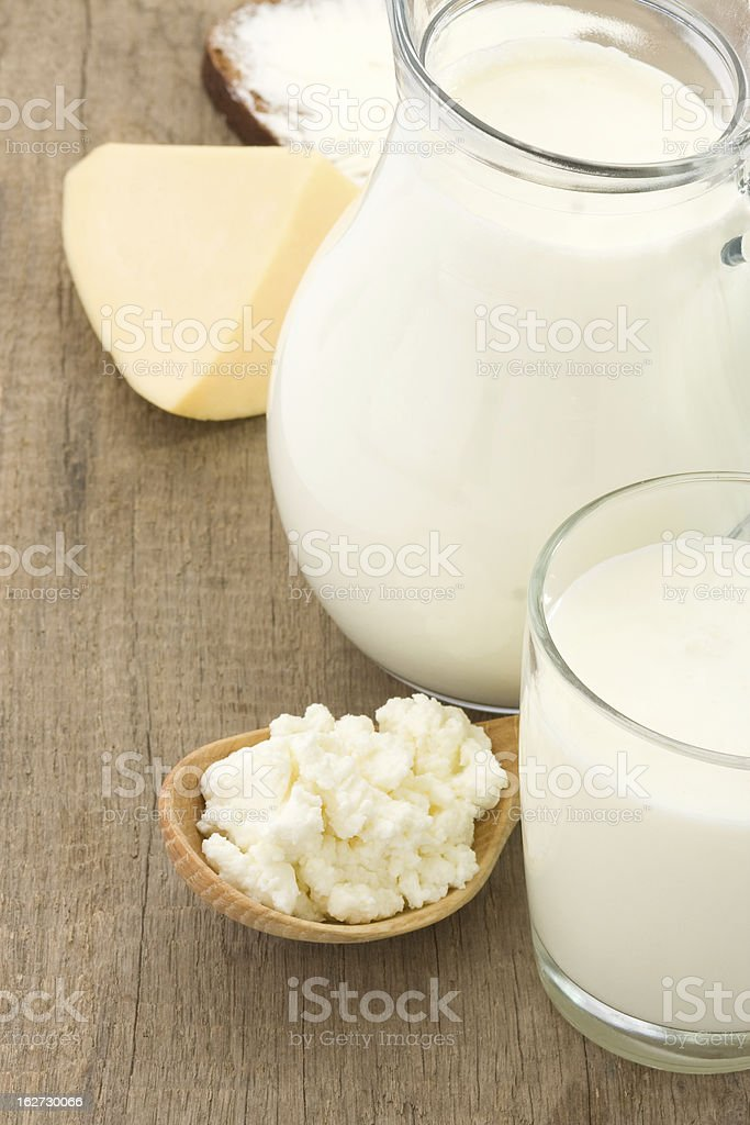 cheese and milk products on wood background royalty-free stock photo