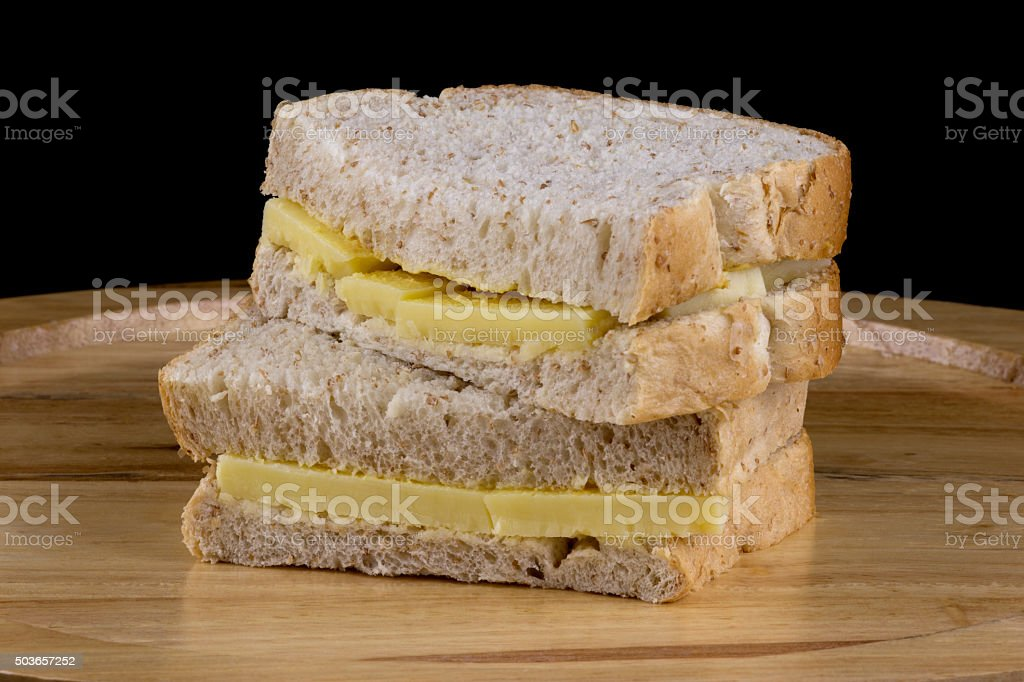 Cheese and Mustard Sandwiches on Wooden Cutting Board stock photo