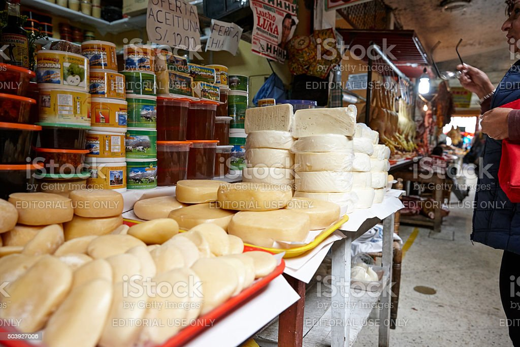 Cheese and olive stall in Huaraz Market stock photo
